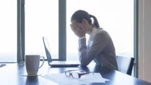 Stressed businesswoman - image sad-at-work-300x169 on http://cavemaninasuit.com