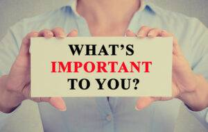 Businesswoman hands holding sign What is important to you - image Whats-important-300x190 on http://cavemaninasuit.com