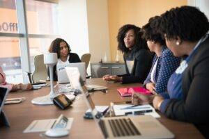 four woman at the conference room